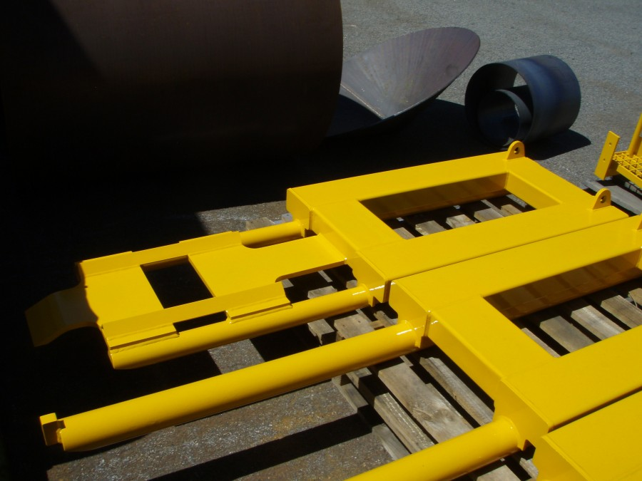Maintenance forklift attachments used to remove track wheels